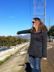 U.S. Army Corps biologist Erin Jones points to one of the soft-bottom areas of the Los Angeles River near North Atwater Park. (Jim Burns)