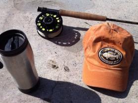 "Just bring the essentials: coffee, rod, reel, ""A Sewer Runs Through It"" baseball cap. (Jim Burns)"