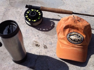 "Just bring the essentials: coffee, rod, reel, ""A Sewer Runs Through It"" baseball cap. (Jim Burns)"