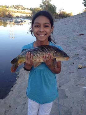 Julia Spilman is all smiles after recently catching this 5-pounder. (Roderick Spilman)