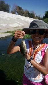 Julia Spilman put her dad's 2 wt. to good use, enticing her first tilapia. (B. Roderick Spilman)