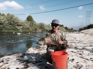 WINNING is what Matus Solobic of Altadena represents with the beautiful common carp. (Jim Burns)