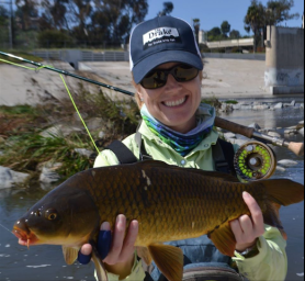 ALL SMILES: Kesley Gallagher hoists an LA River carp in 2014. (Kesley Gallagher)
